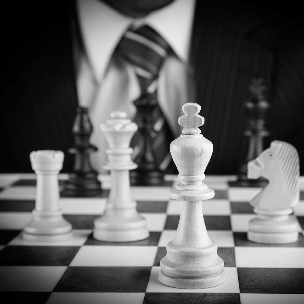 man in suit playing chess